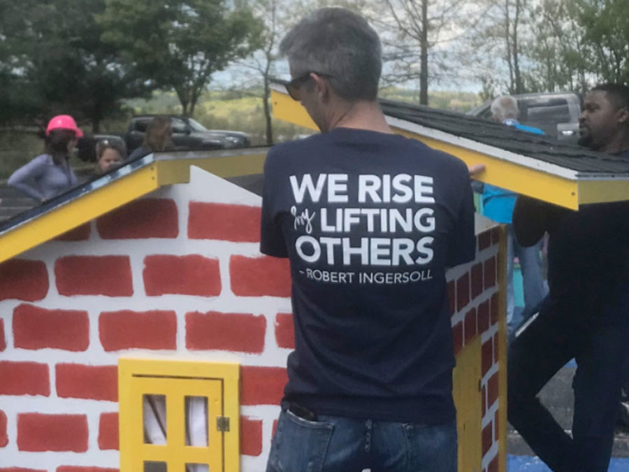 picture of someone building a house with a shirt that says