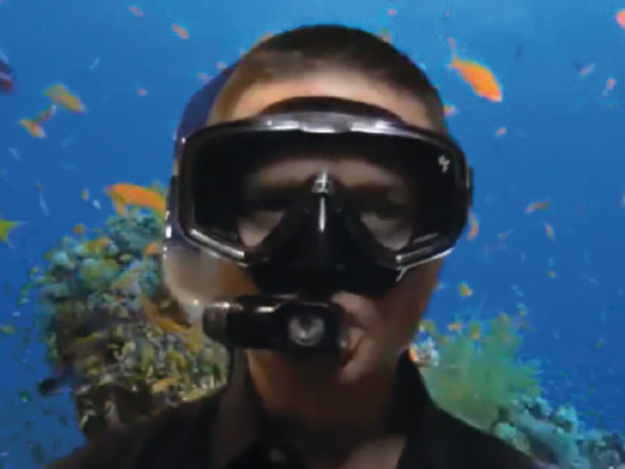 Eric with a snorkel mask and underwater zoom background